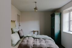 Cotswold Farm Hideaway: A Swiss Family's Cottages for Let in the English Countryside - Remodelista Bert And May Tiles, Vintage Industrial Lighting, Small Cottages, Stay In Bed, English Countryside, Stone Flooring, Little Houses, Living Area, Cornwall England