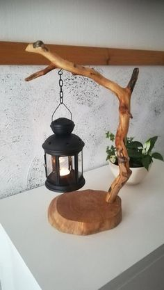 unique table tea lamp candle holder driftwood lantern wooden light DIY gift idea homedecor branch lamp natural handmade design tree crafts handmade unique table tea light lantern. driftwood stick and wood base. interesting decoration for every home. gives a warm and romantic light.