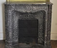 Small #antique #Pompadour #fireplace in Bois Jourdan #marble with its cast iron insert #19thcentury #interiordecoration #louis15 #french #style #design #decor Available on #MarcMaison website