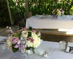 Picnic table set up on the private cocktail patio at Foster's Clambakes and Catering. #mainewedding # floralcenterpiece #picnictable #yorkmaine #mainevenue #yorkweddingvenue #southernmainevenue