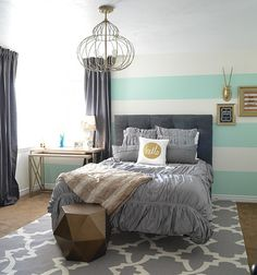 Paint one wall in your room with stripes to create a fun focal point.