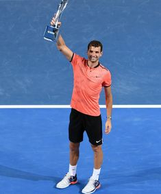 08 JAN 2017: Grigor Dimitrov of Bulgaria lifts his winning trophy after defeating Kei Nishikori of Japan in their men's singles final at the Brisbane International tennis tournament in Brisbane, Australia.