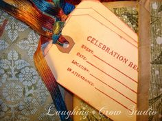 A beautiful way to keep track of your family holiday traditions using a journal made from paper bags, scrapbook papers, and old holiday cards. A great gift for newlyweds to grandmas!  #laughingcrowstudio