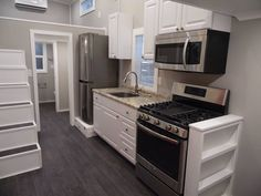 Tiny House Kitchen Built By Tiny House Builder http://www.uppervalleytinyhomes.com/tiny-house-builders.html Tiny House Trailer Builders http://www.uppervalleytinyhomes.com/Tiny-House-Trailer.html