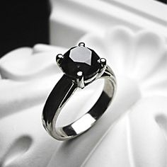 A dramatic alternative to the white diamond, this hand created black diamond ring is elegant, exotic and endlessly fascinating.
