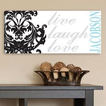 """This gorgeous Live, Laugh, Love filigree canvas print is simple, stylish, and easily customized with the name of your choice. Include your family name for a perfect addition to your living room or personalize it with a first name for a thoughtful gift.  SIZE: 8 x 18 x 1/2""""  Printed on Canvas"""