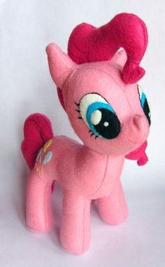 When I asked my brother if there was anything I could make for my niece for the holidays, I was a little overwhelmed when he suggested a My Little Pony -- Friendship is Magic plushie of Pinkie Pie. I'd never sewn a stuffed animal before, and I'd be a pony newbie creating something to give to a pony expert!