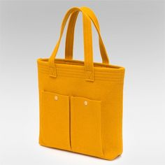 the price is reasonable, but only in a perfect world would this felt tote stay this perfect and pristine and yellow!