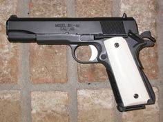 Colt 1911 .45 ACP with Ivory grips
