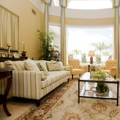 Curved bay windows with a sun roof it seems, high elegant ceiling, and wonderful cream palette Frenchesque furniture!! Glorious!! Yes!!!