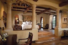 Large master bedroom in luxury Southwest home.  Southwest design scheme throughout with exposed wood beams, adobe appearance, wood floors an...
