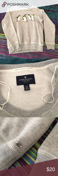 American Eagle Sweatshirt American Eagle sweatshirt with sequin penguins, size MEDIUM, worn once, no signs of wear American Eagle Outfitters Tops Sweatshirts & Hoodies