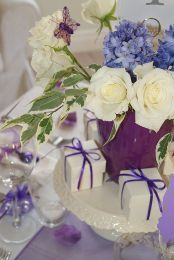 Lovely wedding table decorations - favour boxes wrapped with thin purple ribbon #ribbon #purple #wedding #table #decorations