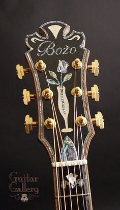 Bozo Archtop Guitar (45th Anniversary) Flame Maple back & sides Hand carved, Old German Spruce top The back is also hand carved Venetian cutaway Built in 20