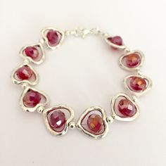 A personal favourite from my Etsy shop https://www.etsy.com/listing/221458119/red-glass-bead-heart-frame-bracelet