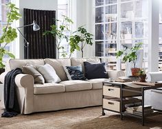 A classical sofa with rounded edges and wonderfully thick, comfy cushions. IKEA EKTORP three-seat sofa in beige cotton/polyester has reversible back cushions that will last for many years.