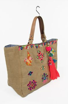 STAR MELA. Zelma Emb Bag.  Large tote bag with multi coloured embroidered designs. Leather handles. Cotton lining and large embellished tassle. Colour - Multi.  Tote bag grande con disegni multicolore ricamati. Manici in pelle. Fodera in cotone. Multicolore.  € 120.00