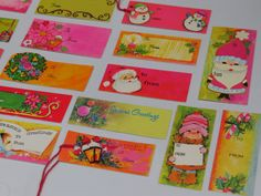 Pretty retro pink red gold and green colors. You get all pictured above. There are 22 gift tags and 5 seals. Gift tags vary in size and shape. They are in excellent unused condition. Seals are great for decorating envelopes, cards or small gifts. Would be sweet used at table setting/placement cards, homemade ornaments, etc.  Happy Memory Making:)