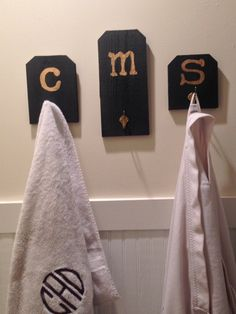 "Reclaimed fence board into personalized towel racks to stop the ""you used my towel!"" argument"