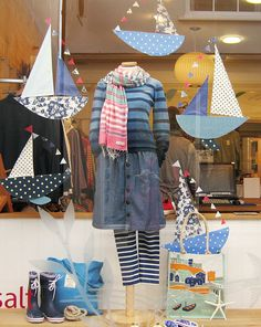 Hand made boats around mannequin by Seasalt window team.