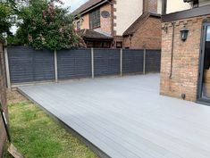 The Maritime Grey decking complements our customer's choice of fencing and brings light to their garden! Back Garden Landscaping, Backyard Patio, Backyard Layout, Outdoor Landscaping, Grey Gardens, Back Gardens, Outdoor Gardens, Deck Railing Design, Patio Design