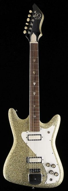 1964 Kay E200 with some mods and a gold sparkle finish --- https://www.pinterest.com/lardyfatboy/