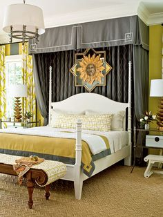 Love the curtains behind bed and valance with trim work around it! Plus love the dark color and white headboard!