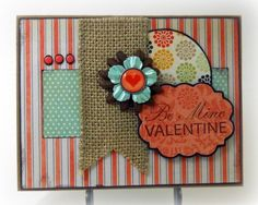 I like the combination of different patterns and embelishments on this card.