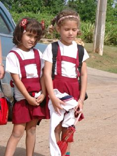 Cuba - School kids in the Caribbean are always immaculately turned out and these girls near Havana in Cuba were no exception. They are also usually keen to practise their English on the visitor
