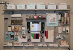 Craftroom Pegboard by Missy Allaire on SouthLakeMoms.com.  I love the paper cutter hanging.