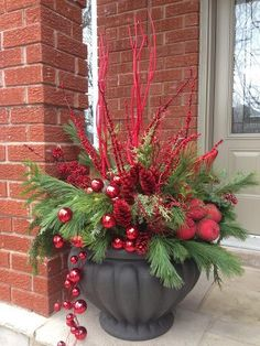Another great outdoor holiday arrangement. Get the kids involved with picking out the pieces around the home, as well as spraying them with fun Glitter Spray Paint! #ChristmasDIY #DIY ( Could use silver, clear,blue and maybe white's with this pot! )
