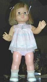 """1965-1967 Baby First Step, Talking Baby First Step, 18"""" tall, battery operated talker or walker, rooted hair, sleep eyes. Unsure if she is shown in original outfit."""