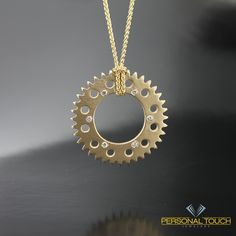 14kt yellow gold Motorcycle sprocket necklace from Personal Touch Jewelers.