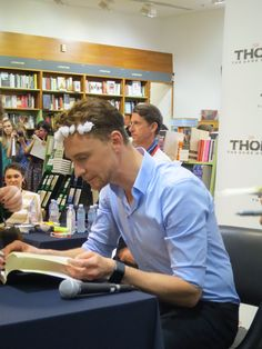Tom in Sydney. With. A. Flower. Crown... <3