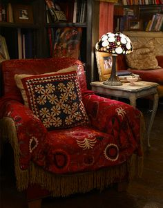 I'd love to slipcover a chair like this - I need the lamp too!