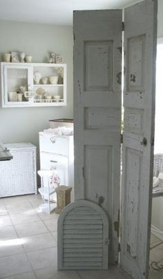 Chikd room: An old door cut in half and hinged.