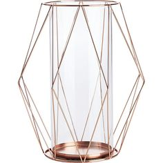 """mcguire hurricane    CB2 Delicate copper cages the glow of a single pillar candle. Metal wire is cut to size then sculpted and welded into deconstructed diamond-like facets. Tall at over 10"""", candle casts a warm copper glow at any angle. Glass insert reflects light and keeps the pillar in place."""