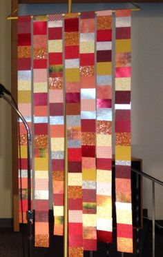 Pentecost Banner made by taping together squares of scrapbook paper....powerful in its simplicity.
