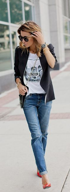 Christine Andrew is wearing a black and white graphic T-shirt, black blazer from Forever 21, skinny boyfriend jeans from Mossimo, shoes from Red Patent and a bag from Valentino