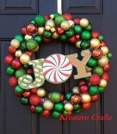 Red, Gold and Green bulb ornament Christmas Wreath.  Call Kreative Crafts for your one of a kind handmade door wreath, teacher gift or holiday gift. Visit www.ilovekreativecrafts.com or like my FB page Kreative Crafts .
