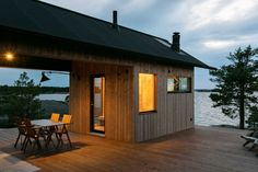 Finnish designers Aleksi Hautamaki and Milla Selkimaki purchased a island two years ago, on the edge of the Archipelago National Park in Finland, and have since built this self-sufficient summer house that includes a sauna, a guesthouse and a Summer Cabins, Solar, Exterior Cladding, Wooden Stairs, Cabin Homes, Cabins In The Woods, Interior Exterior, Panel, Amazing Architecture