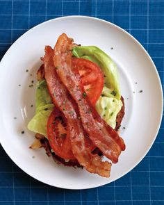 Savory French-Toast BLT  Savory chive-studded French toast is topped with that irresistible trio, bacon, lettuce, and tomato. Serve this easy, creative open-face BLT for brunch, lunch, or dinner.  RECIPE: http://www.marthastewart.com/275103/bacon-recipes/@center/854190/comfort-food-recipes?xsc=SOC_FB_baconrecipes