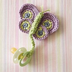 Cute idea however NO Pattern- Pattern was published in Crochet! Magazine, Spring 2011: Easy Living Crochet- Dragonfly Pacifier Holder