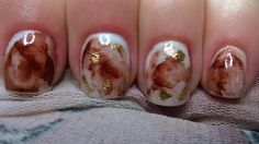 short sculpted white acrylic with marbling effect and gold leaf