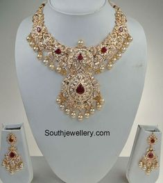 22 carat gold bridal cz and ruby necklace set. For inquiries contact: Swarnsri Gold and Diamonds Vijayawada, Whatsapp number : 9393891000 Gold Earrings Designs, Gold Jewellery Design, Necklace Designs, Gold Jewelry, Bridal Jewellery, Gold Designs, Diamond Jewellery, Pendant Jewelry, Wedding Jewelry