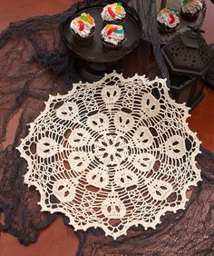 Skulduggery Doily Isn't this just gorgeous. Who wouldn't want to have this on their table. Beautiful in white but can also imagine it in black, red and grey.