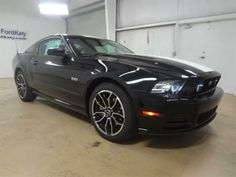 2014 Ford Mustang GTPremium GT Premium 2dr Coupe Coupe 2 Doors Black for sale in Katy, TX Source: http://www.usedcarsgroup.com/used-ford-for-sale-in-katy-tx