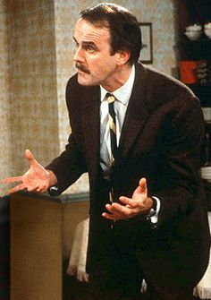 "Basil Fawlty (John Cleese)is the main character of the British sitcom ""Fawlty Towers"". British Comedy Series, British Sitcoms, British Actors, Top 10 Comedies, Classic Comedies, Comedy Tv, Comedy Show, Radios, Fawlty Towers"
