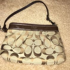 Coach wristlet Brown coach wristlet, perfect condition! I just never use it! Coach Bags Clutches & Wristlets