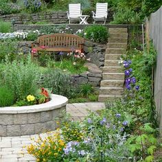 A challenging landscape becomes a tiered garden with multiple places to sit and enjoy the view. | thisoldhouse.com